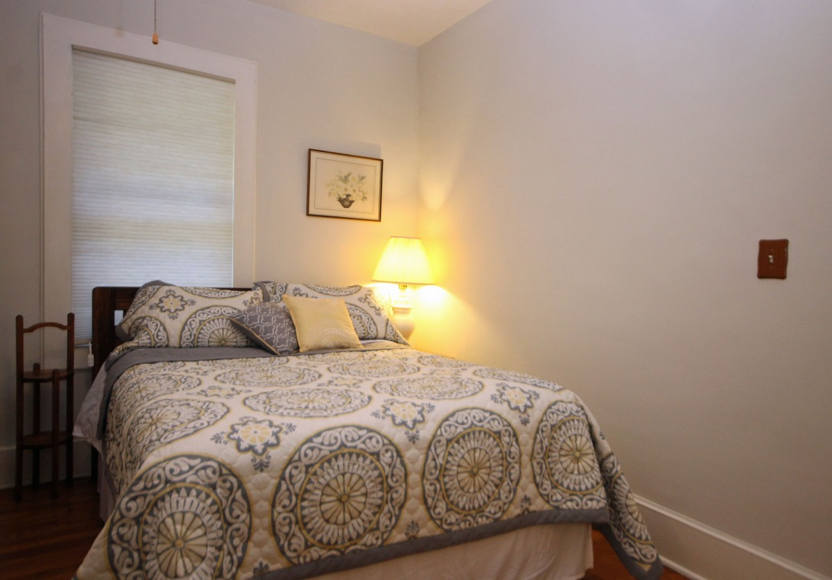 The main bedroom features a comfy Queen bed.