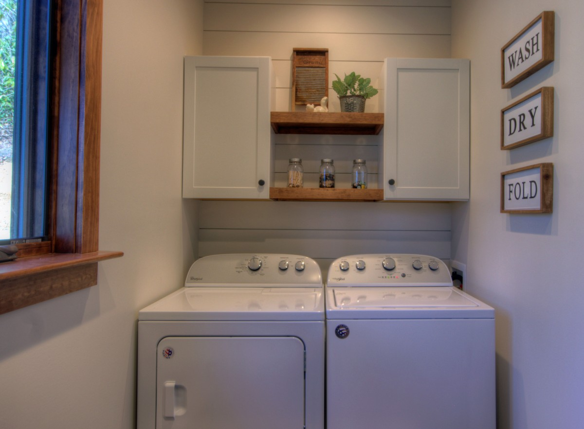 Laundry room, located right inside the front door to the left, features a full sized washer and dryer