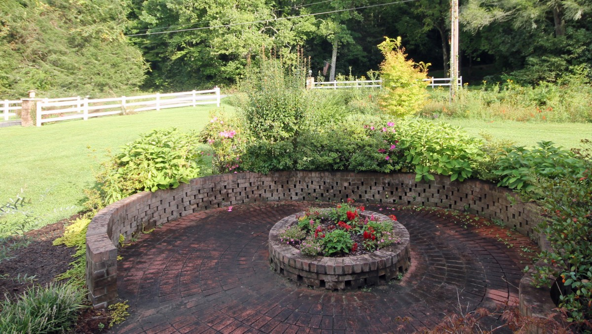 The brick patio with its flower garden is just outside the front door.