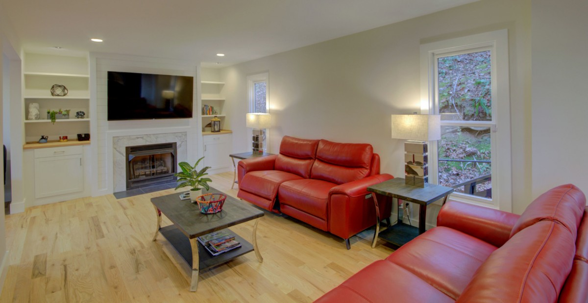 The living room is next to the kitchen and has a fireplace with gas logs, a large TV and amazing comfy reclining leather sofas.