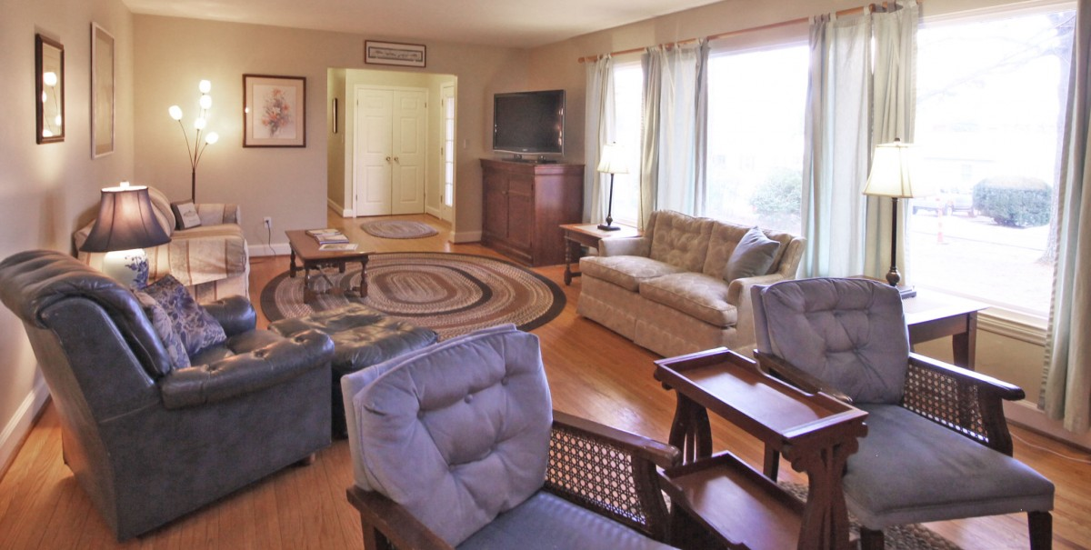 The living room is sunny and bright, and has lots of seating so you can entertain and relax.