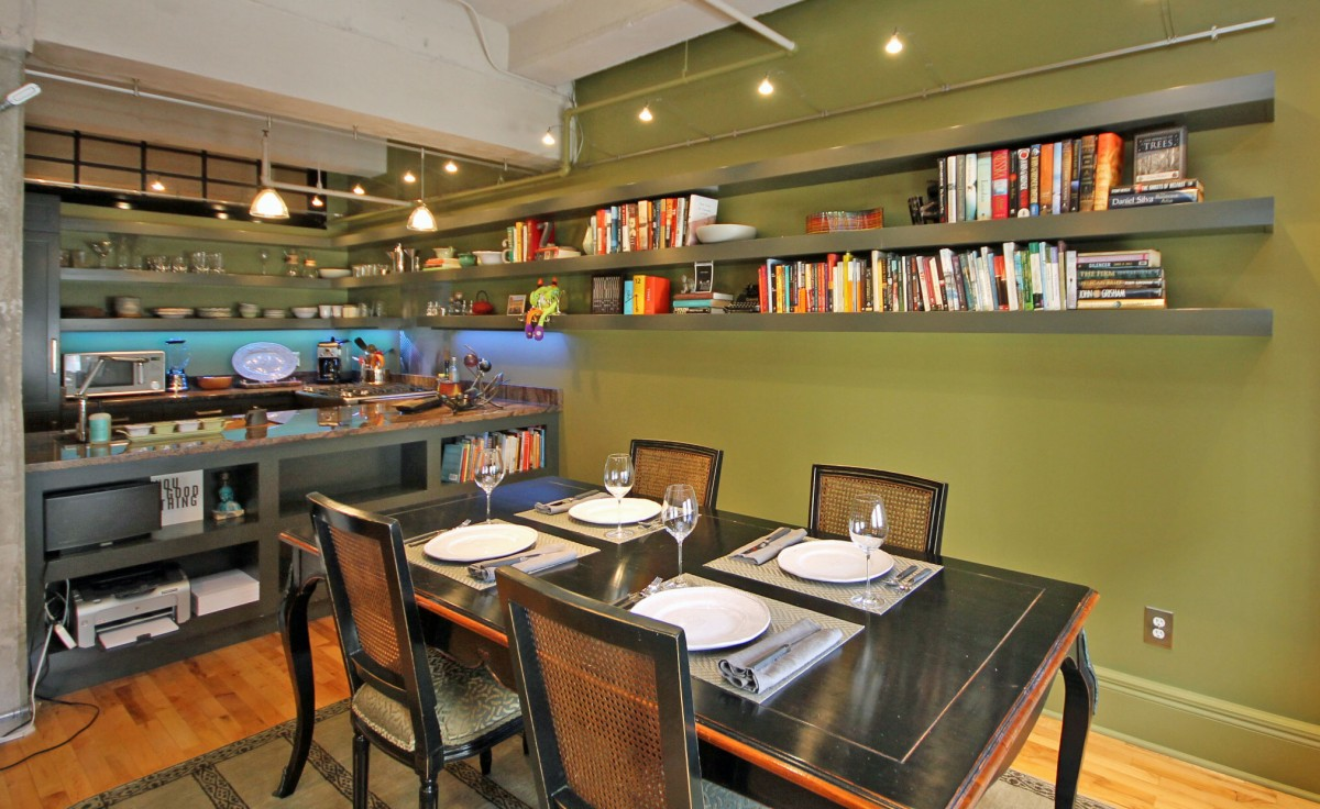 With a wireless printer and shelving located below the bar, the dining table can also serve as a workspace.