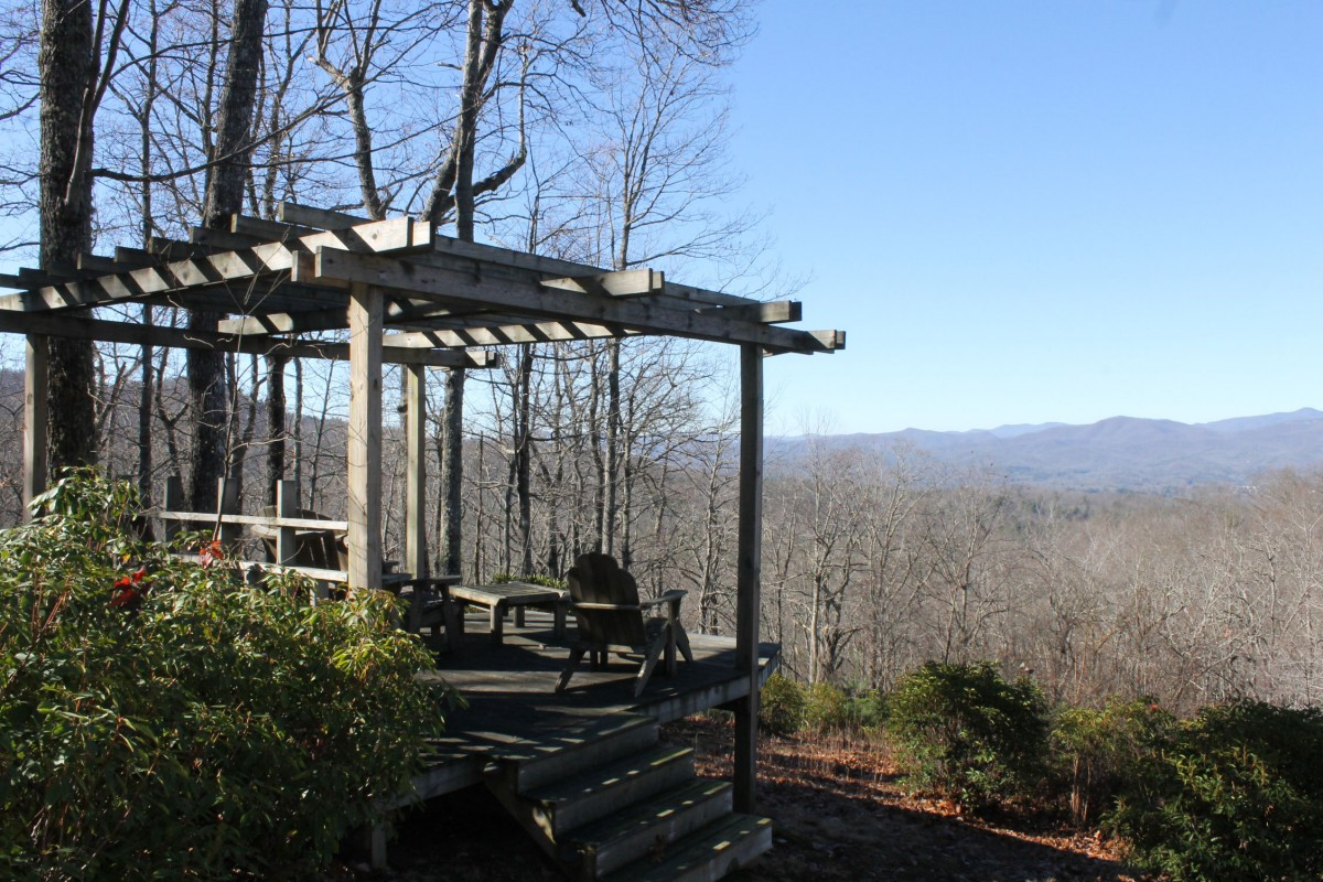 The gazebo invites you to come and sit as you enjoy the spectacular mountains that surround Brevard.