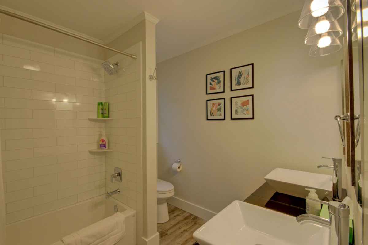 The upstairs bath has dual vanities and tiled shower enclosure.