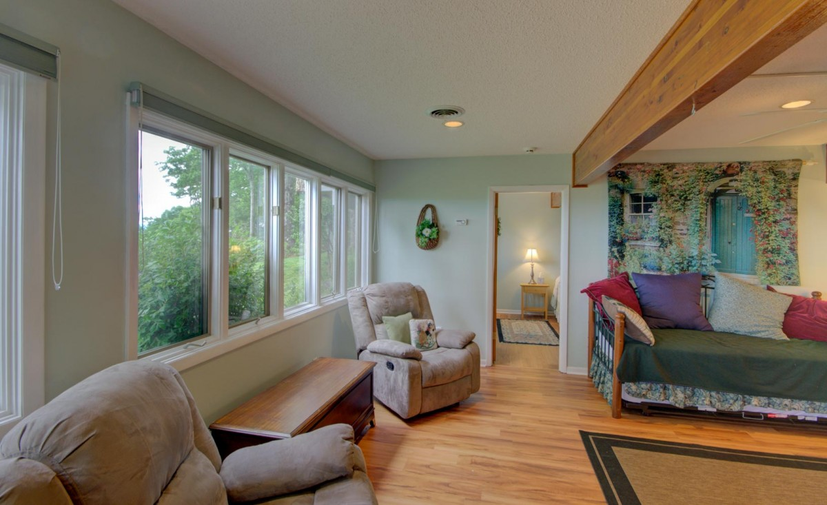 The downstairs living area is located between the two lower level bedrooms.