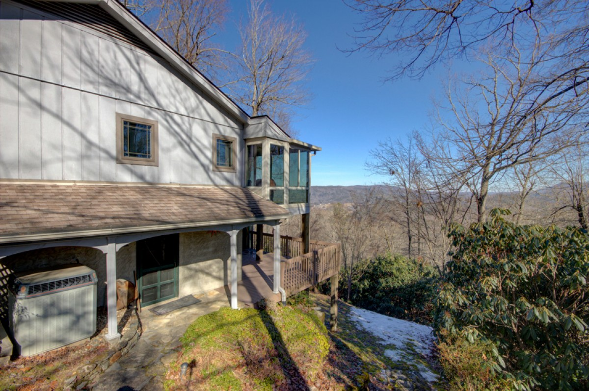 Our home is perched on the edge of a hillside and provides breathtaking views of the mountains beyond.