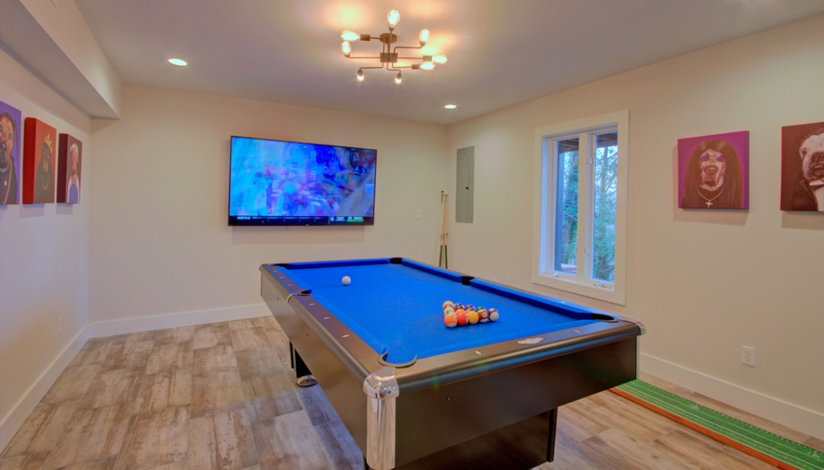 Pool table and TV in the lower level game room