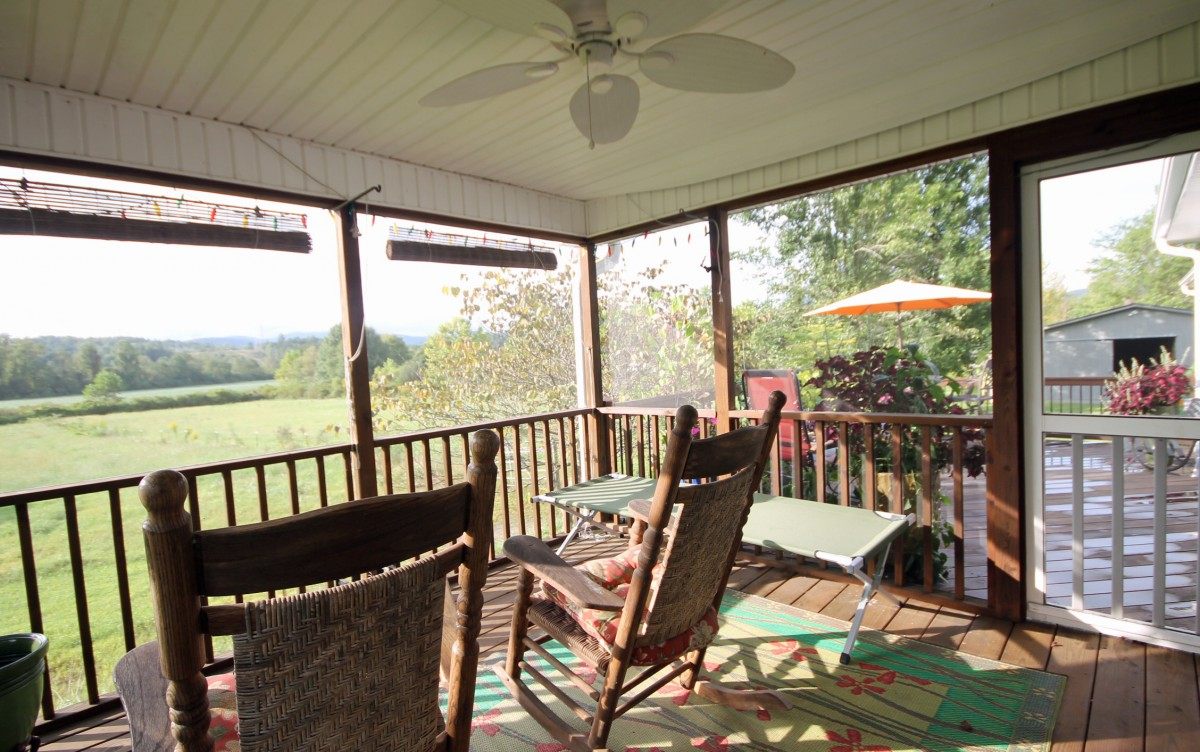 The screened porch is a great place to relax and enjoy the view.