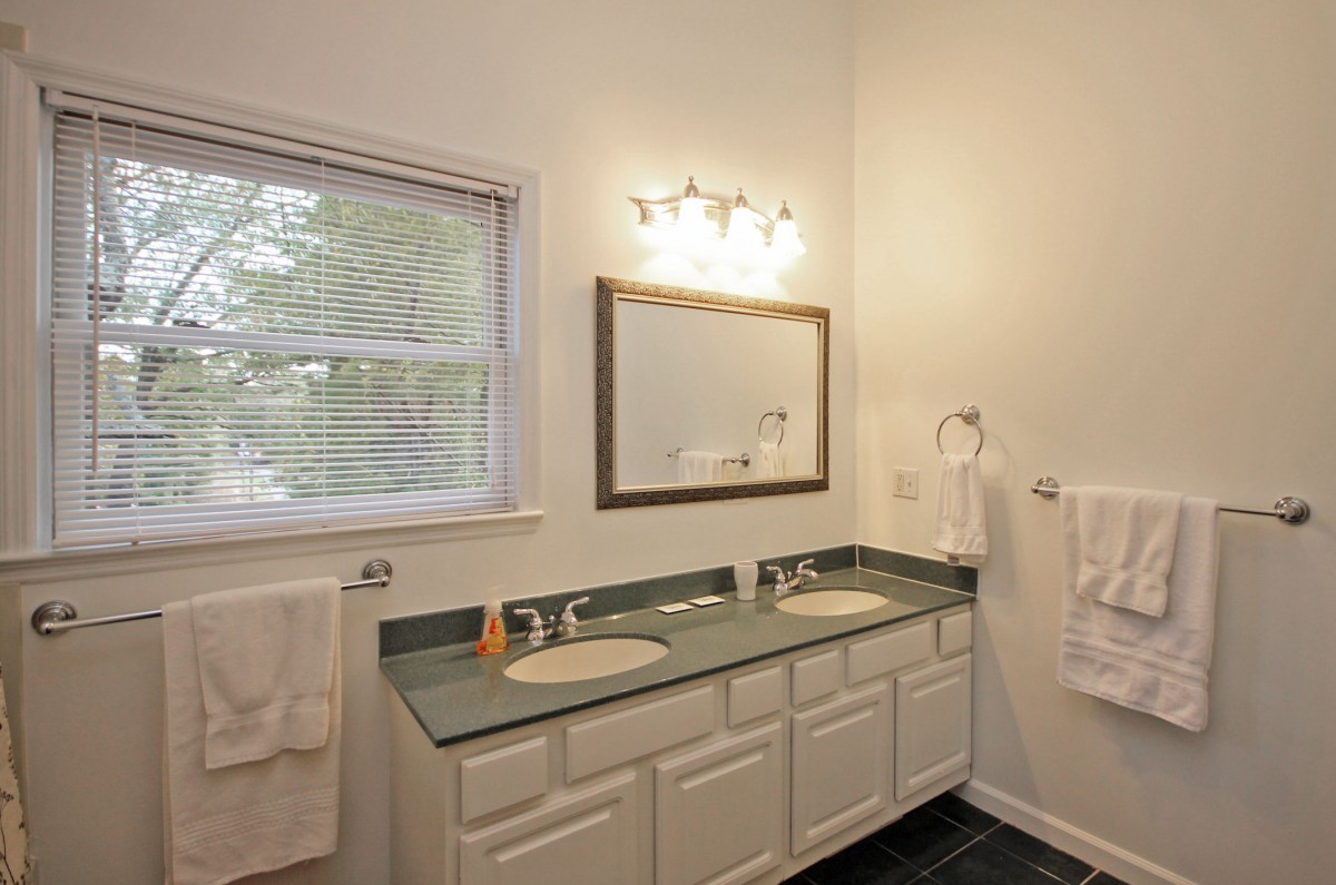 We are big fans of dual vanities, and we love how this bathroom turned out. The bathroom is accessible only through the master bedroom so please be aware of this before booking.