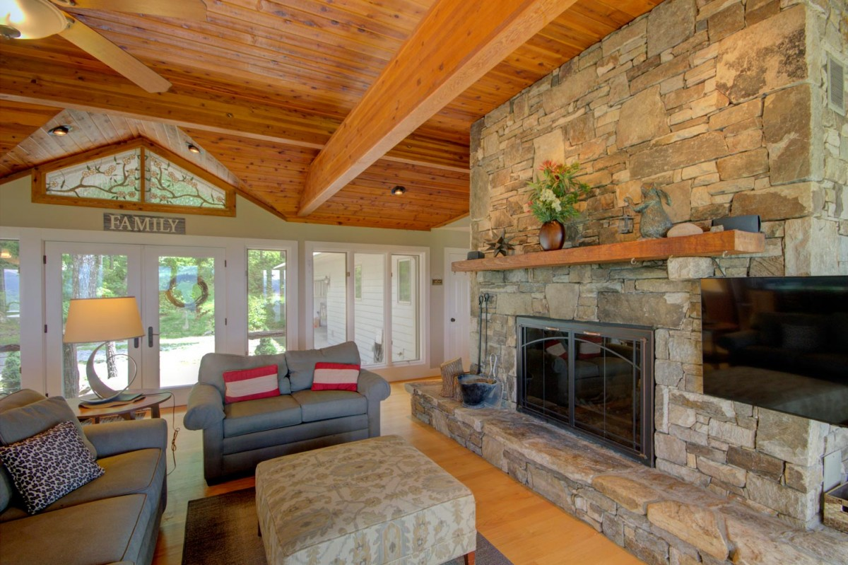 The massive stone wood burning fireplace is the centerpiece of the upstairs area.