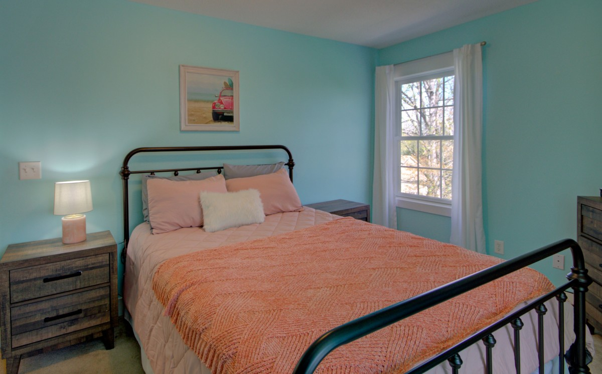 Cozy and bright second upstairs bedroom.