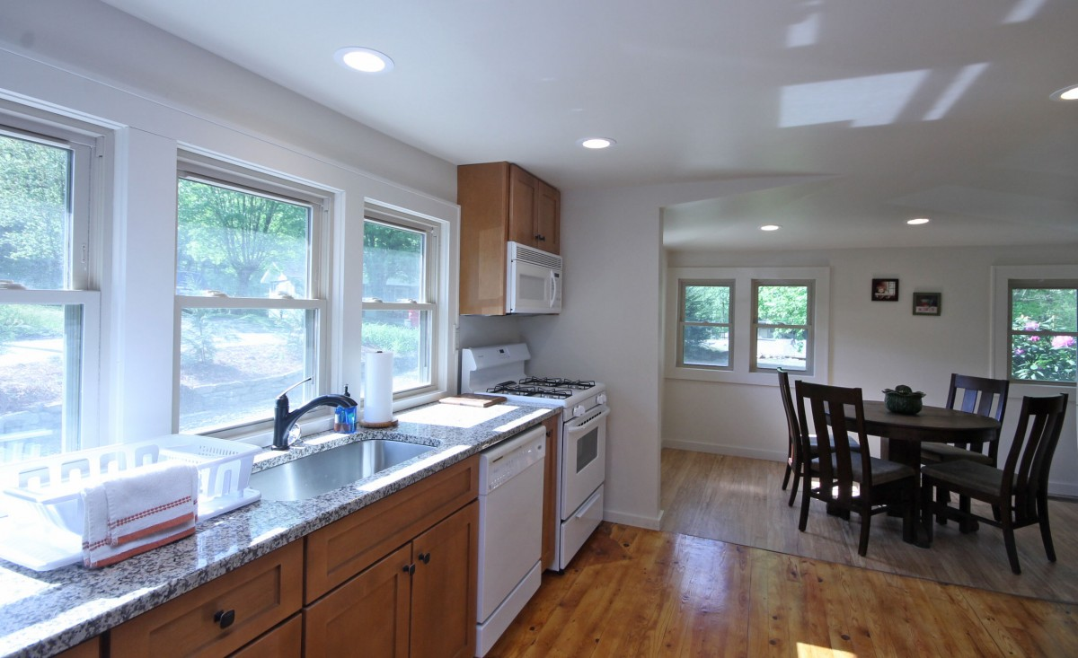 The kitchen features a row of windows that really let the sun in!