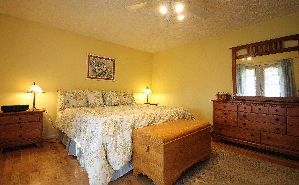 The master bedroom features a comfy King bed and beautiful furnishings.