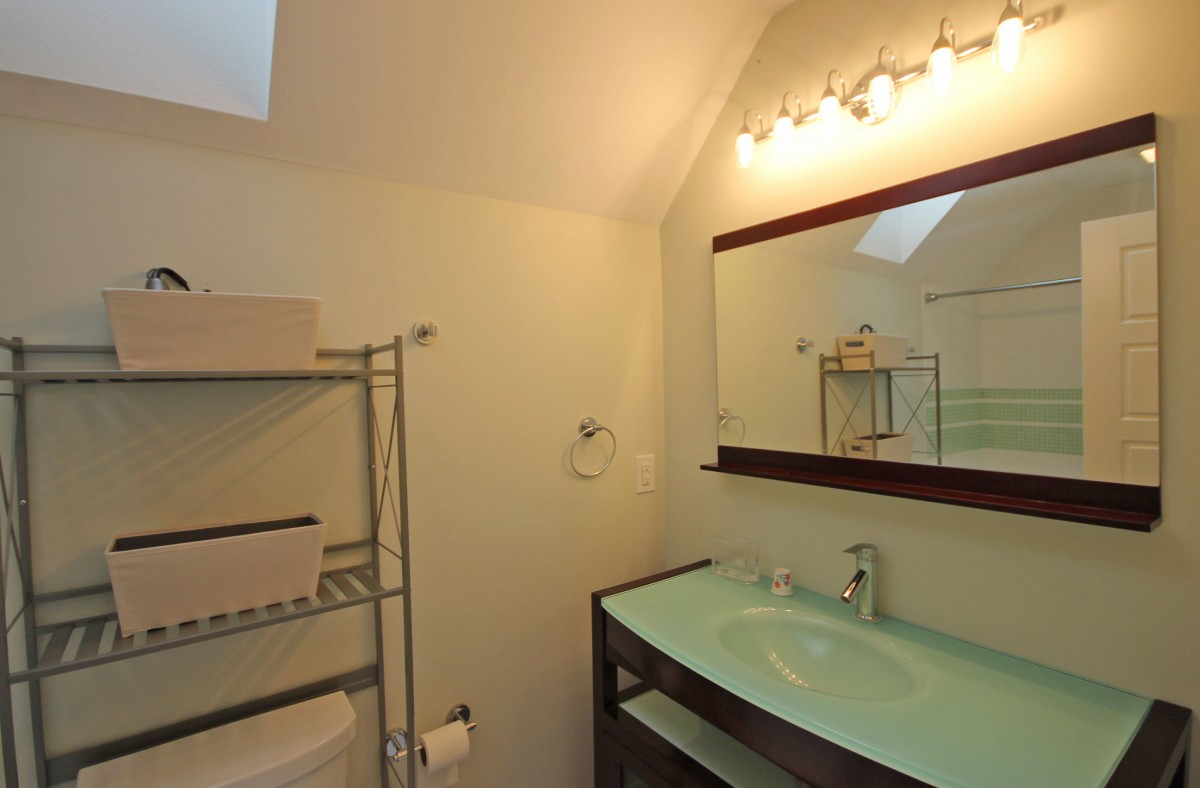 The upstairs bath has a skylight and beautiful fixtures.