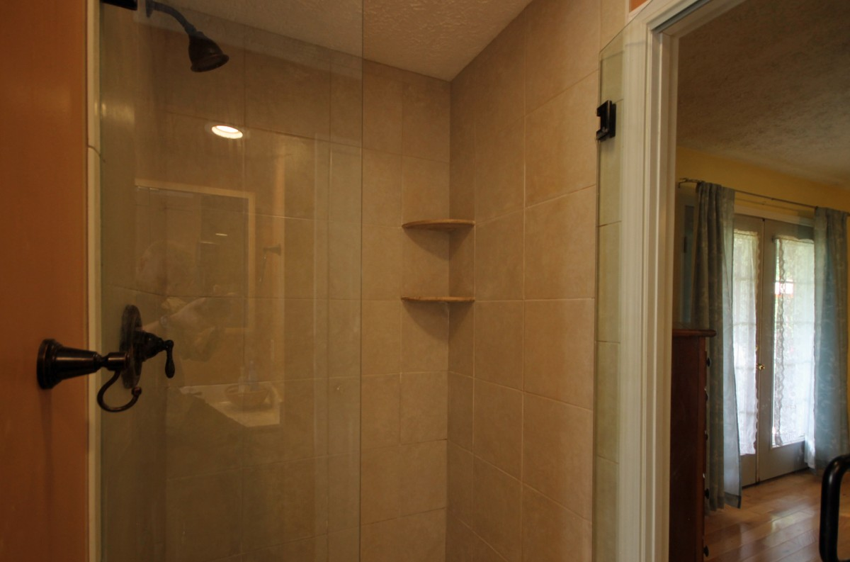 This big tiled shower is the best feature of the master bath.