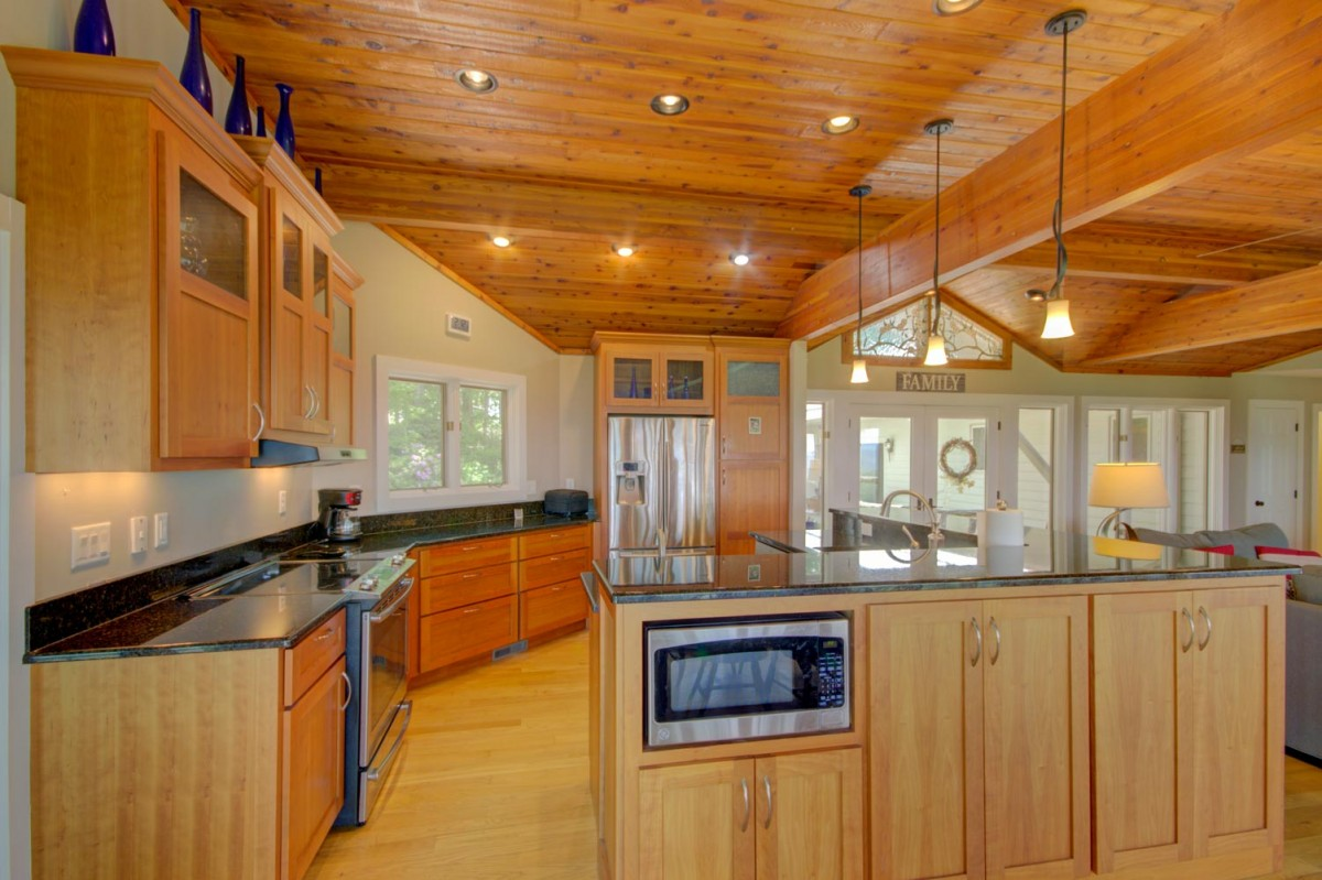 You will appreciate the big open kitchen with its spacious granite counter tops.