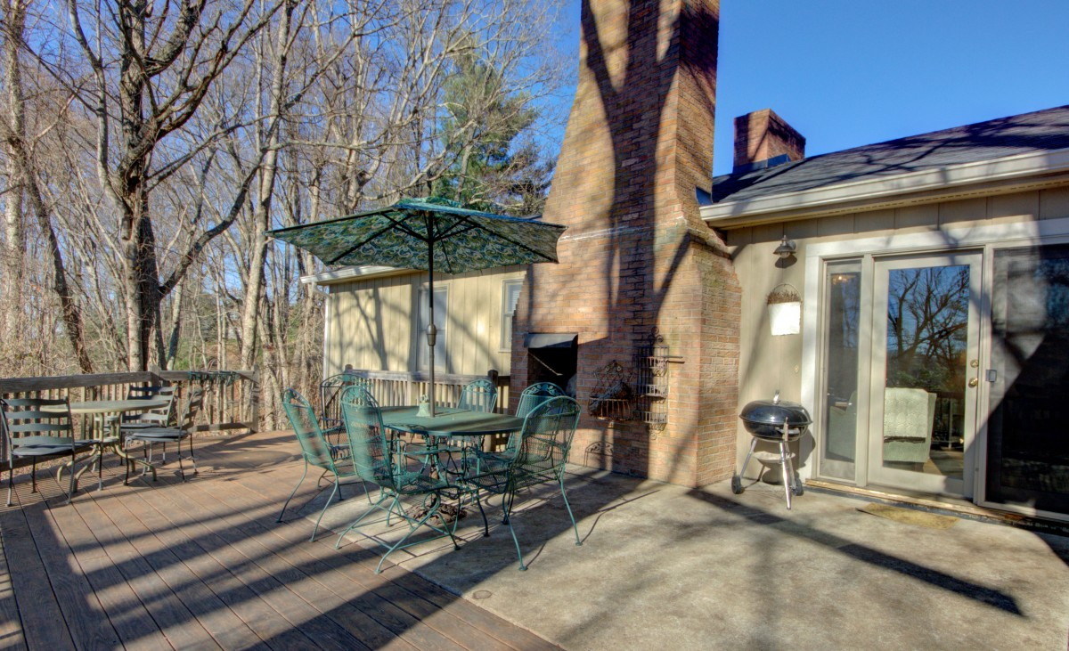The deck also features a grill, outdoor seating and outdoor fireplace.