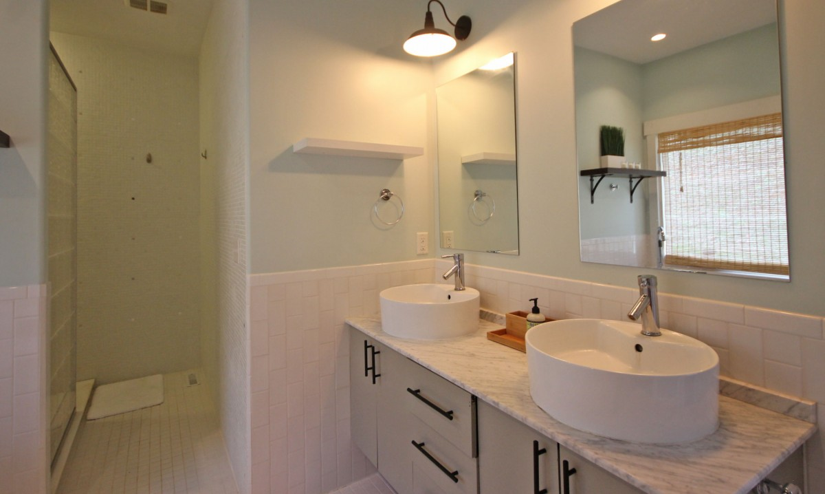 Luxury bath amenities await just off the master bedroom.