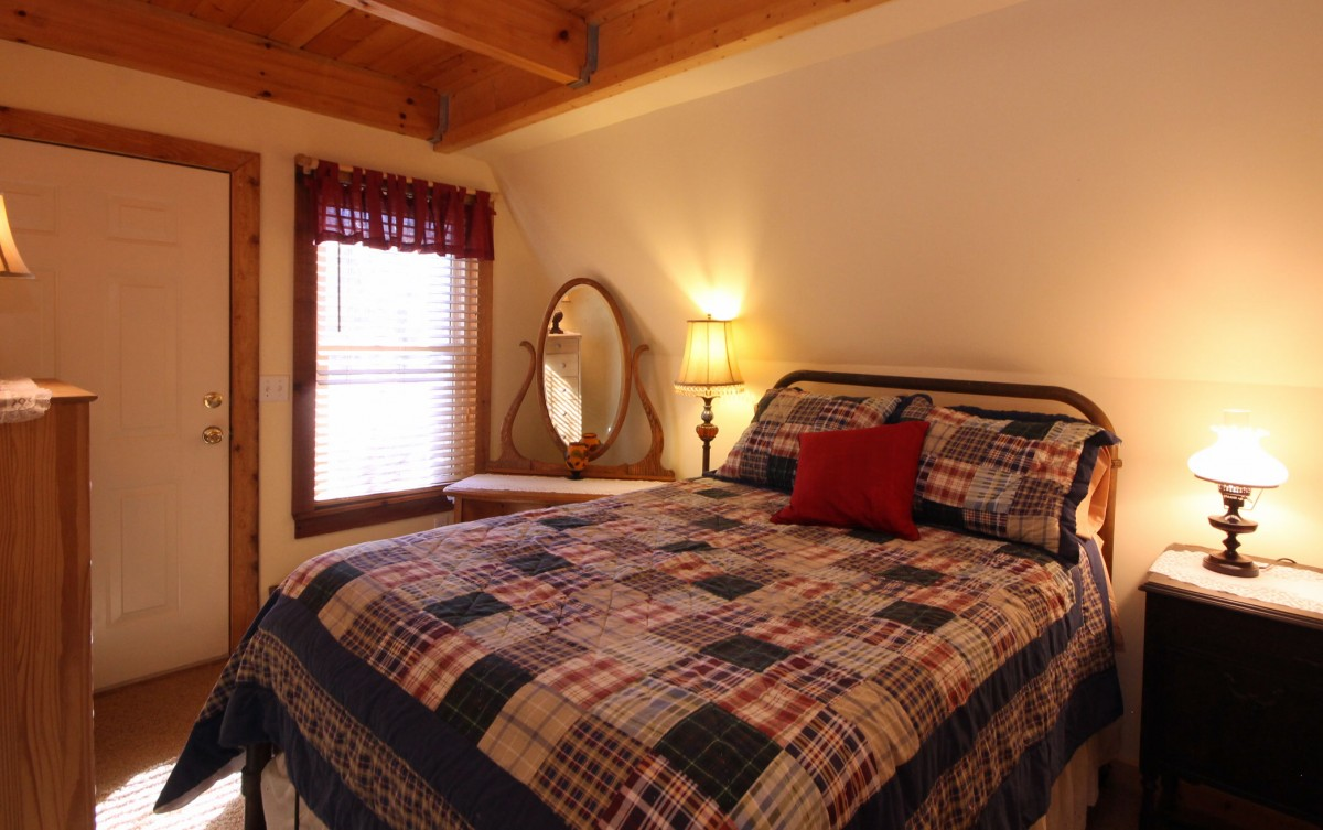 This is the full size bed in the first downstairs bedroom. We love the warm cozy feel of this room.