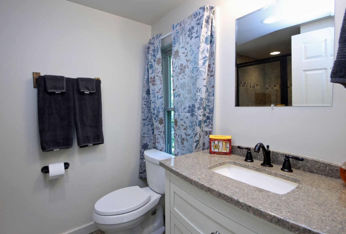The master bath features granite, a tiled shower and all new fixtures.