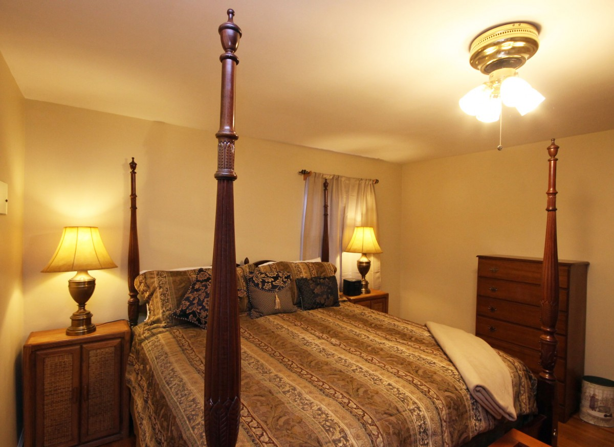Gorgeous master bedroom features a king size bed and plenty of space to relax and unwind.