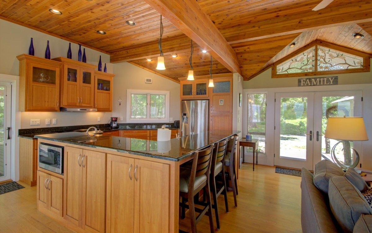 Barstools along the kitchen island provide additional seating.