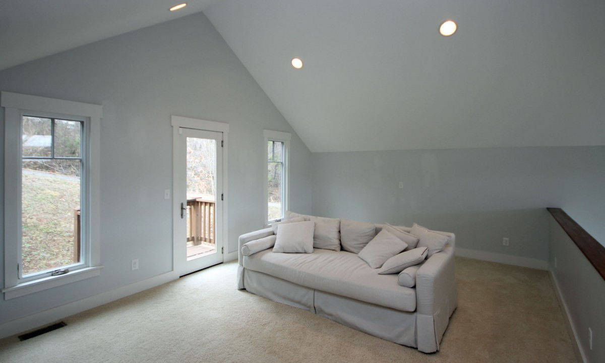 We plan to create a work area by installing a desk along the far wall behind this sleeper sofa.