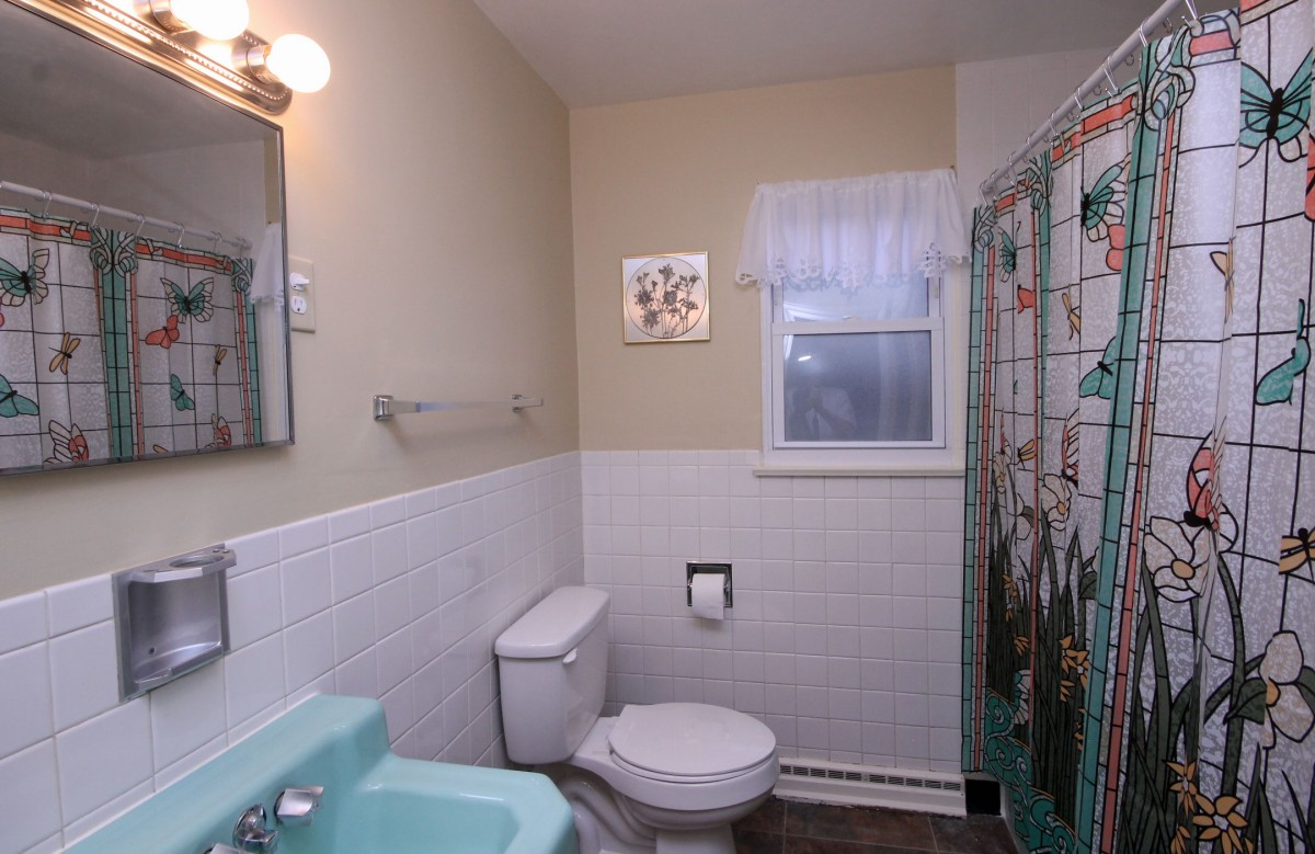 The main bedroom serves the two smaller bedrooms and has been recently renovated. It features a brand new toilet, vanity, lighting, and floor.