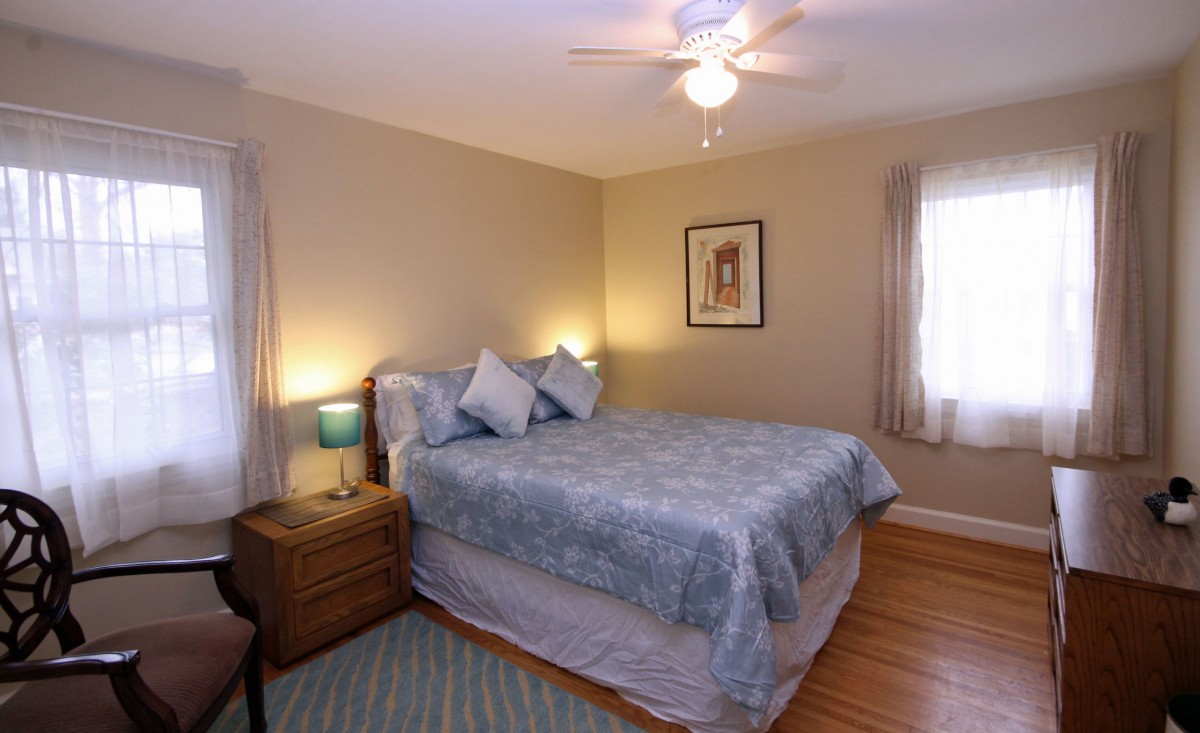 The second bedroom is spacious and peaceful, and features a comfortable queen size bed.