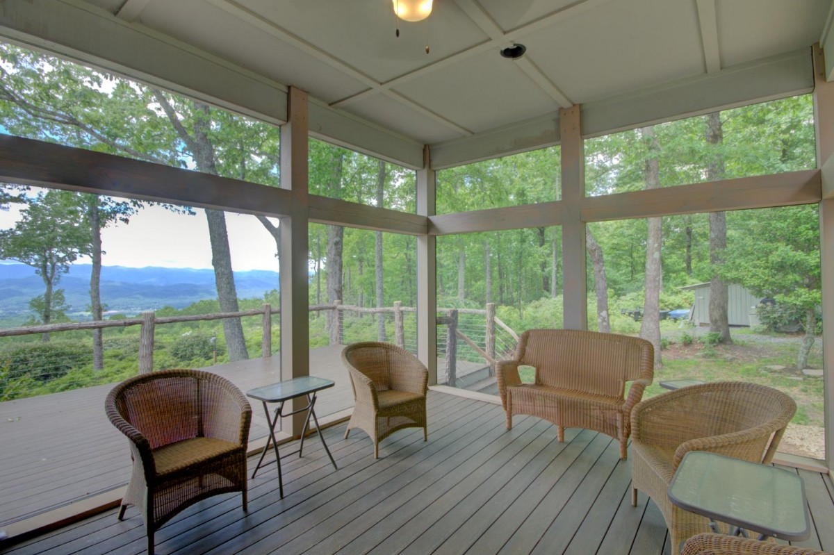 The screened porch just off the kitchen offers a view without bugs
