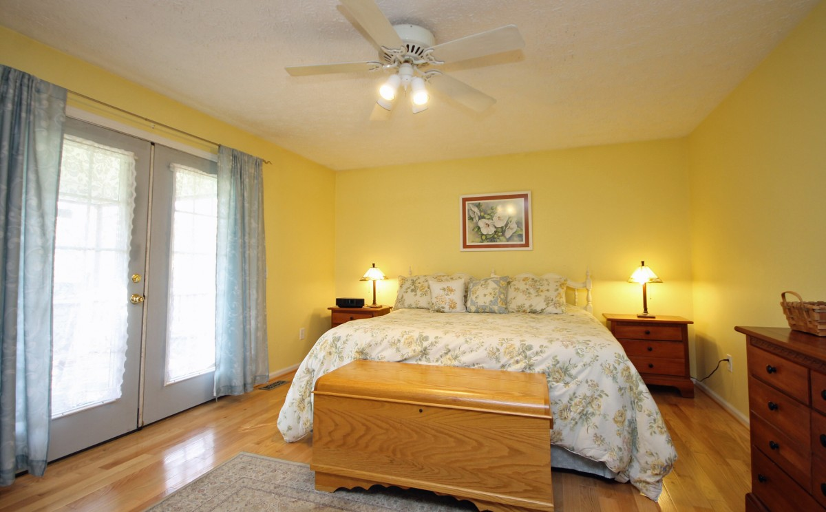Lots of light makes the master bedroom cheerful and bright.