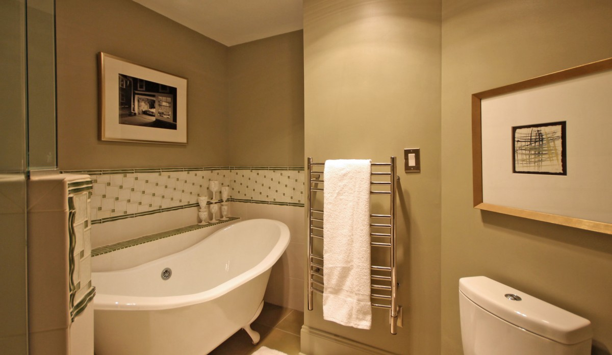 When you step from the clawfoot tub or walk-in shower, warm towels await.