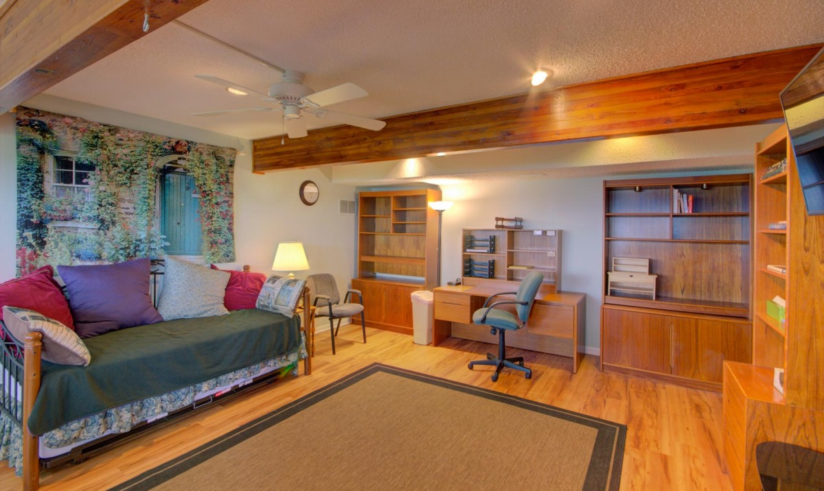 The downstairs living area has a daybed that can be pulled out to create two twin beds.