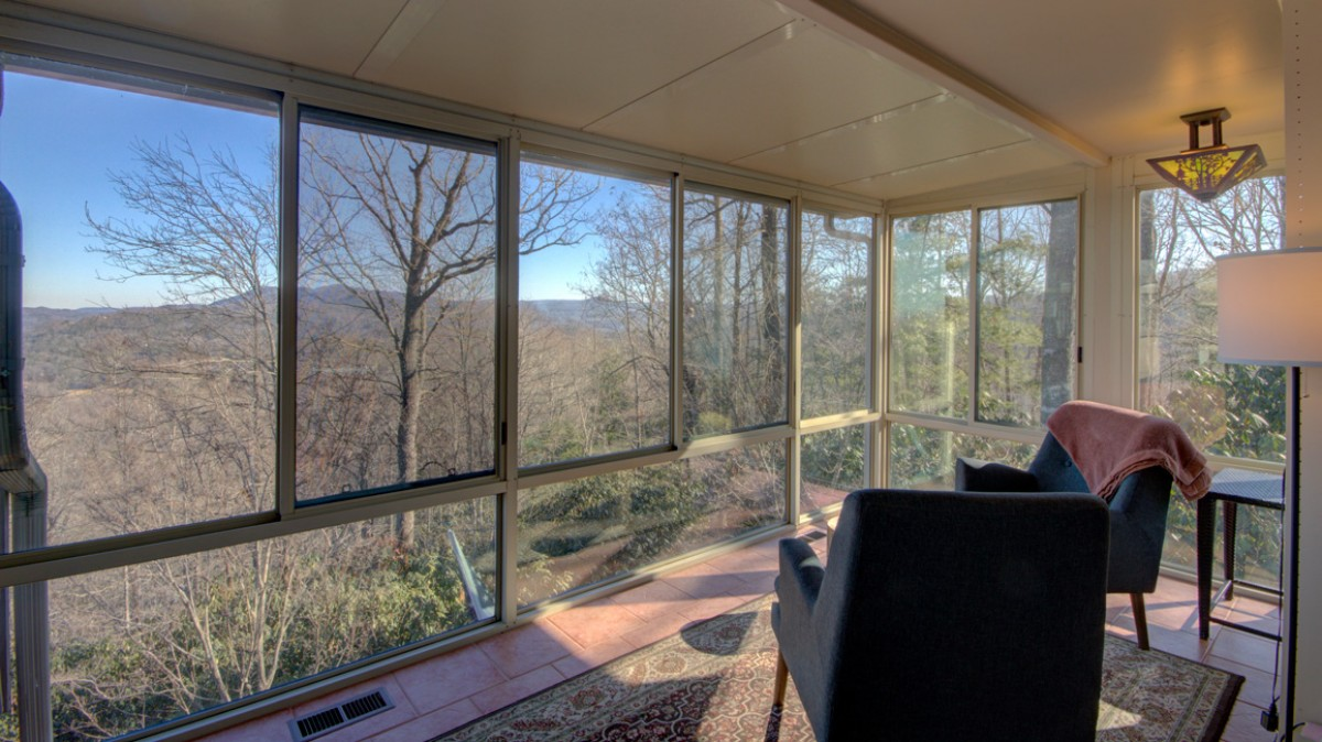 The solarium just outside the master bedroom has phenomenal views and also connects to the outdoor deck.