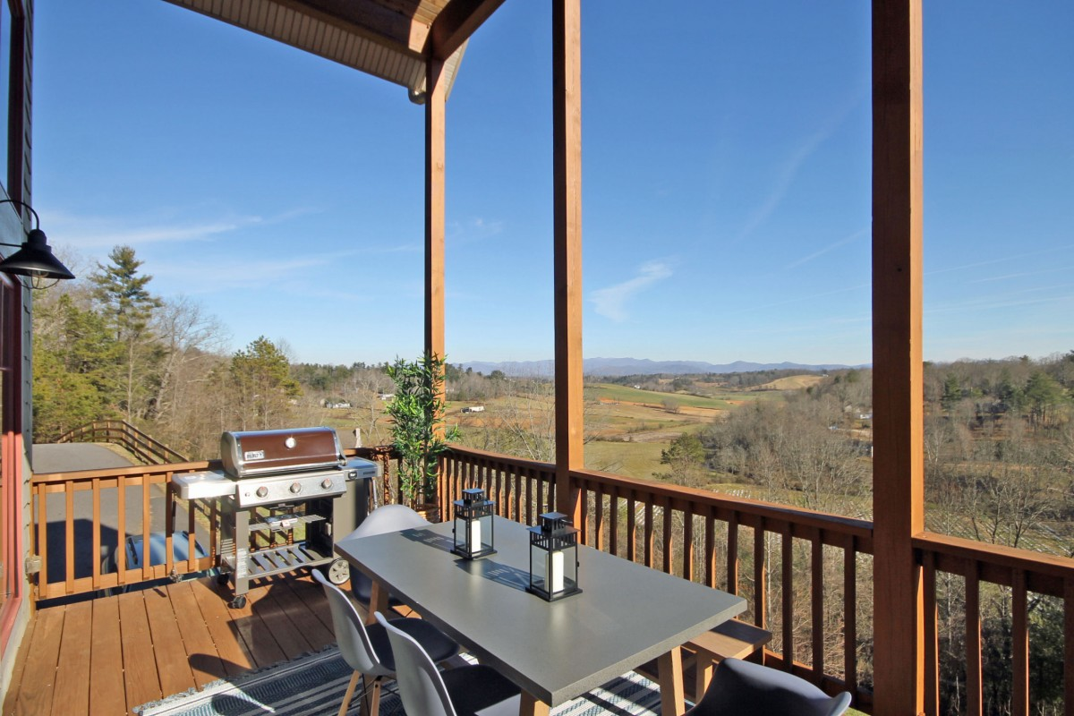 Enjoy the view as you grill and relax in this covered outdoor seating area on the upper deck.