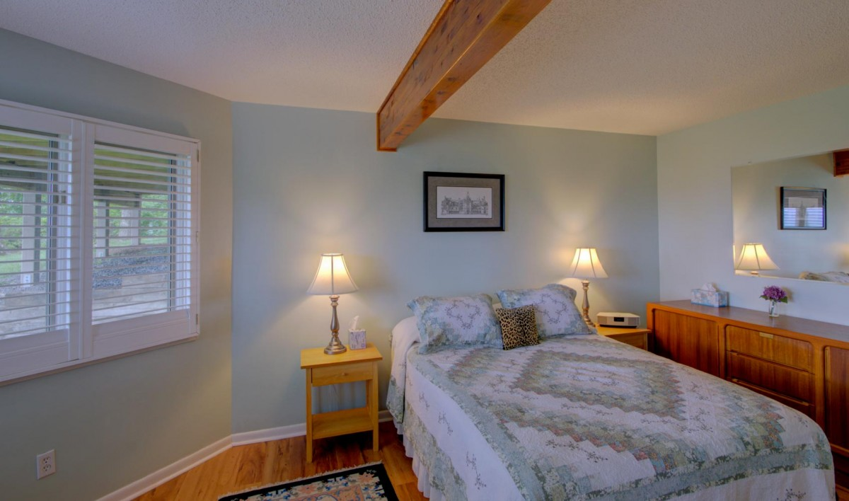 The second downstairs bedroom is well lit by the view windows.
