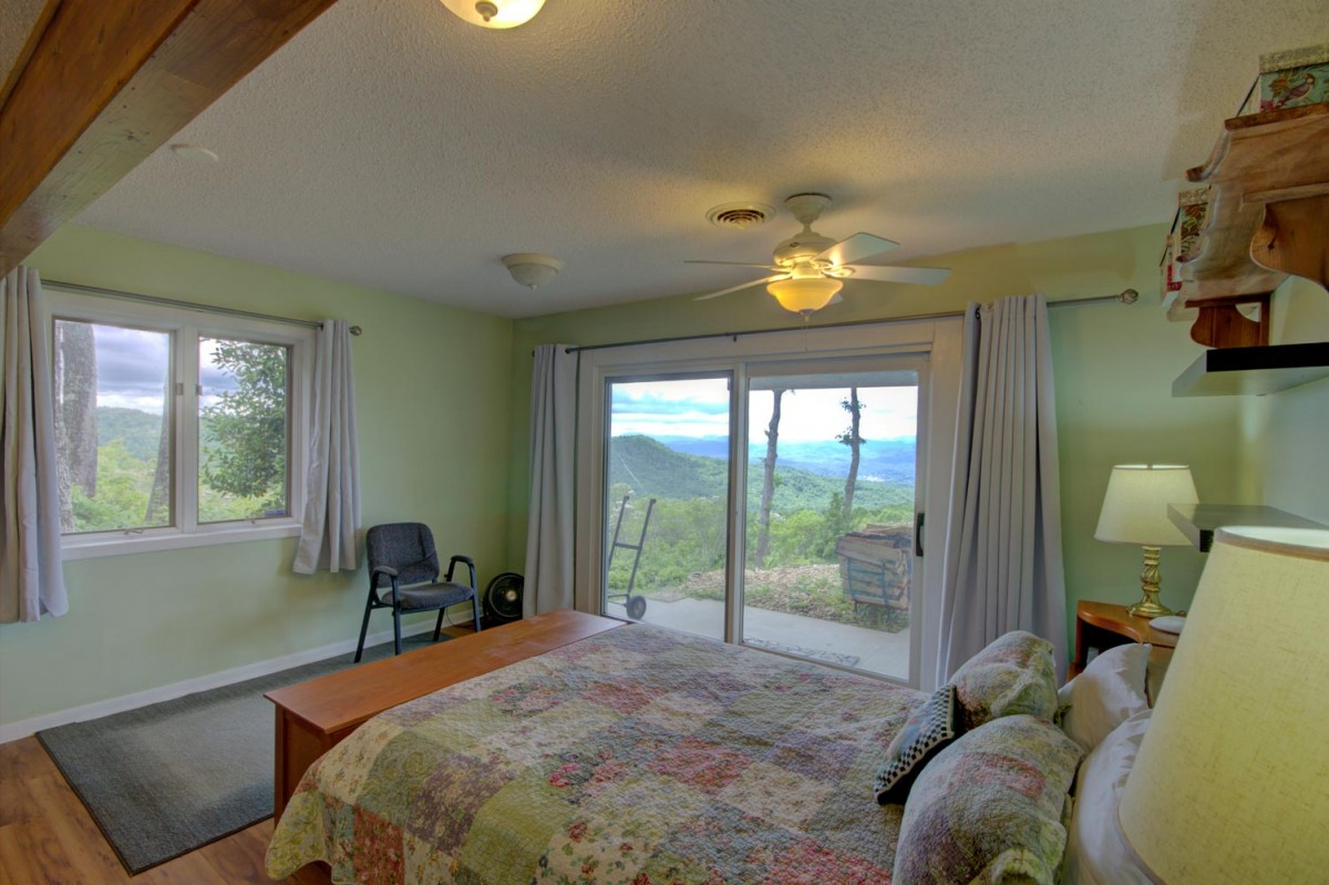 The first downstairs bedroom is cheerful and bright and has its own view.