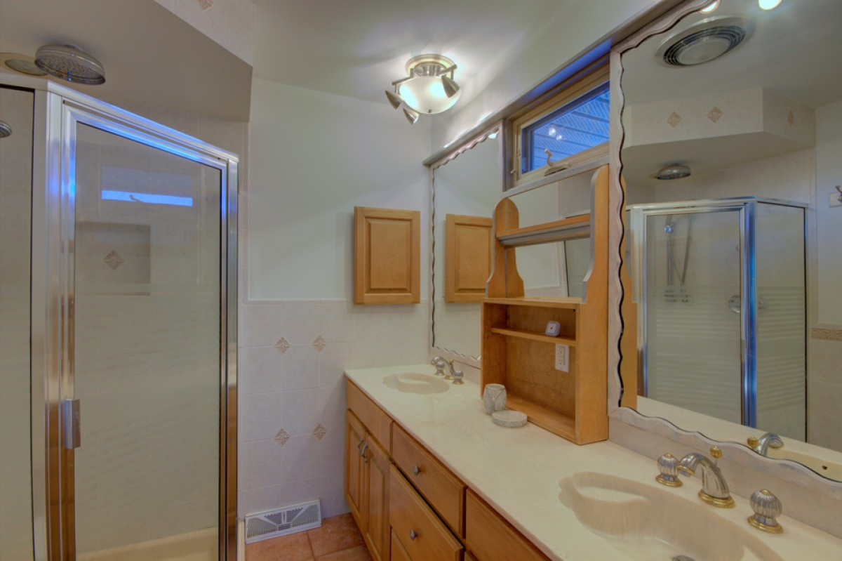 The master bath features dual vanities and generous shower.
