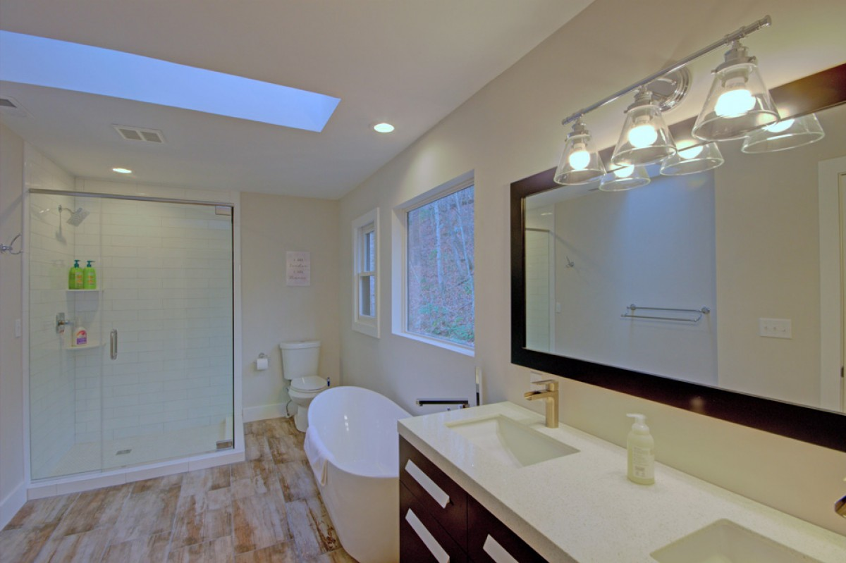 The master bath features double vanities, large tub and walk-in shower
