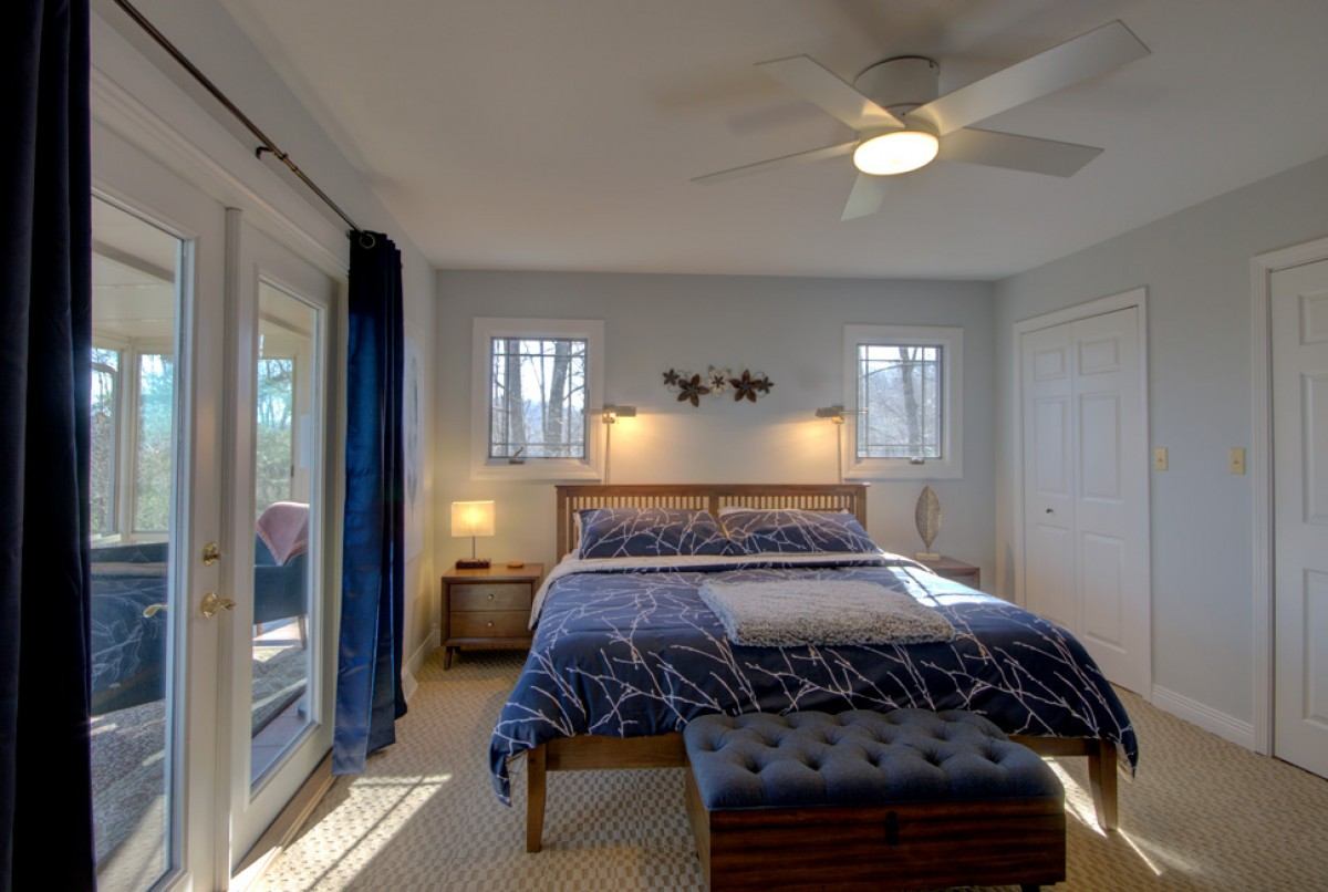 Master bedroom has a king bed, lots of light and a generous amount of space.