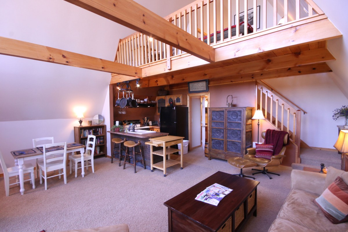 We love the feel of the wood beams that stretch out over the living area.