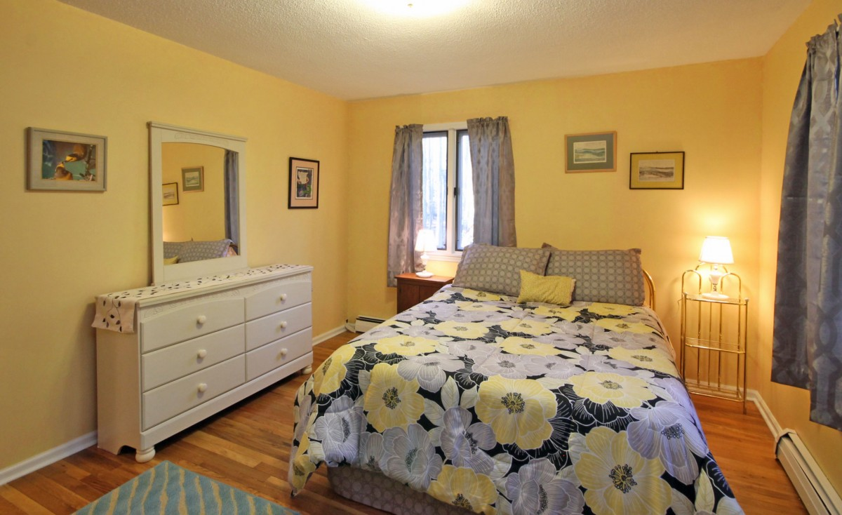 Another view of the guest bedroom, with its cheerful yellow color scheme.