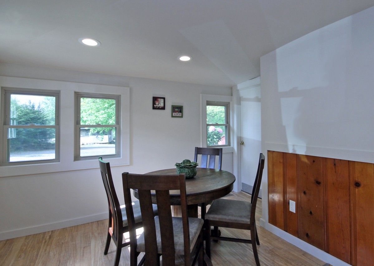 This bright dining area is adjacent to the kitchen.